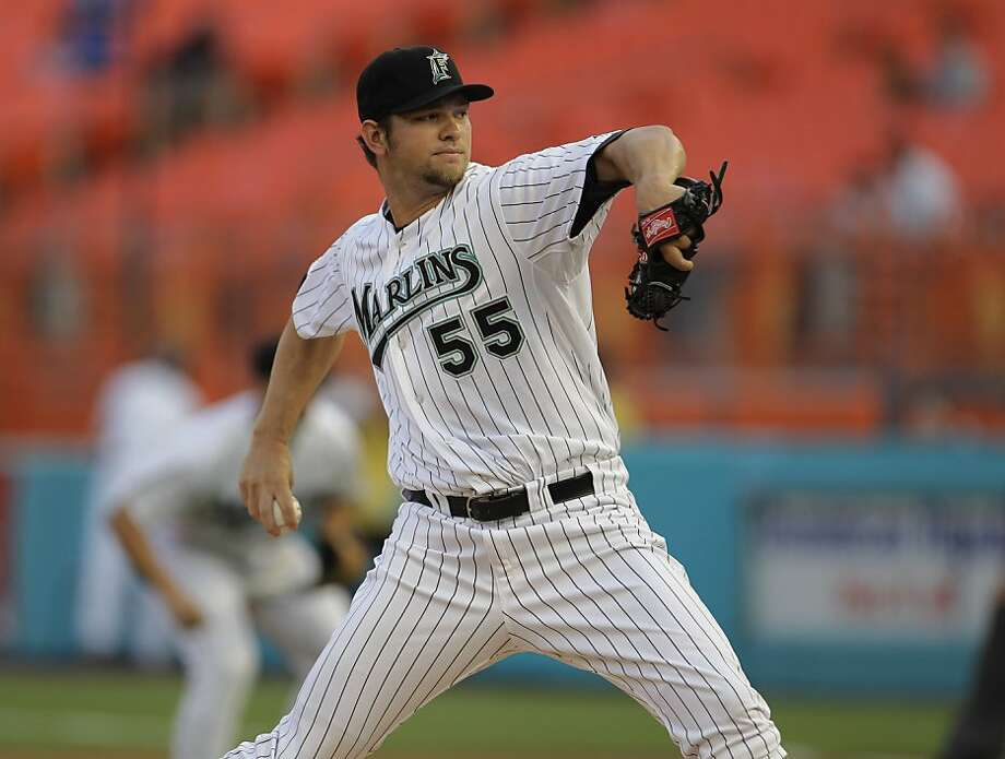 Florida Marlins starting pitcher Josh Johnson throwing to the Pittsburgh Pirates during the first inning of a major league baseball game in Miami, Tuesday, April 19, 2011. Photo: J Pat Carter, AP