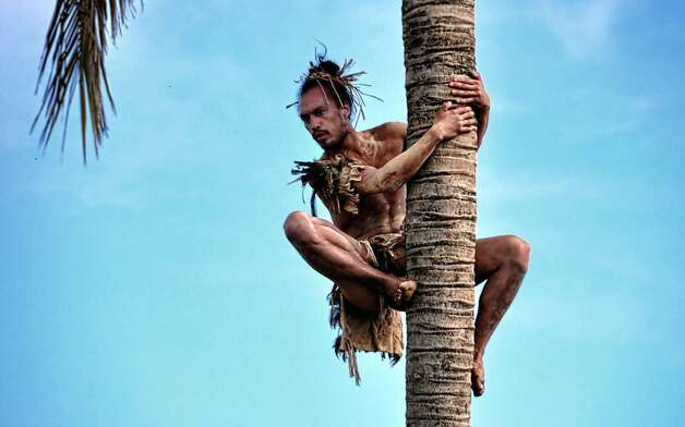 A Rapanui native climbs a tree on Easter Island, 3700 km off the Chilean coast in the Pacific Ocean, on July 12, 2010. AFP PHOTO/Martin Bernetti (Photo credit should read MARTIN BERNETTI/AFP/Getty Images) Photo: Martin Bernetti, AFP/Getty Images