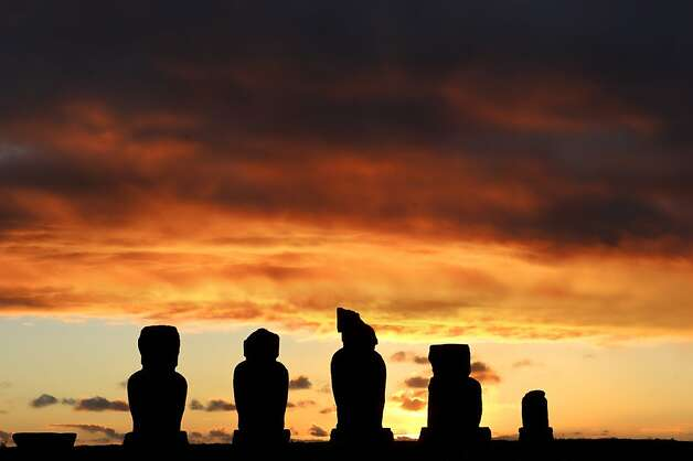 The sun sets behind Moais -- stone statues of the Rapa Nui culture -- on Easter Island, 3700 km off the Chilean coast in the Pacific Ocean, on July 12, 2010. AFP PHOTO/Martin Bernetti (Photo credit should read MARTIN BERNETTI/AFP/Getty Images) Photo: Martin Bernetti, AFP/Getty Images