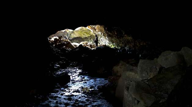 A tourist walks inside Ana Te Pahu cave on Easter Island, 3700 km off the Chilean coast in the Pacific Ocean, on July 13, 2010. AFP PHOTO/Martin Bernetti (Photo credit should read MARTIN BERNETTI/AFP/Getty Images) Photo: Martin Bernetti, AFP/Getty Images