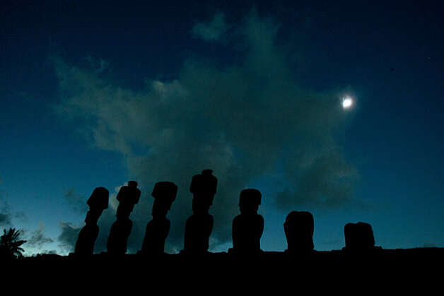 Stone statues known as Moais are pictured during the total solar eclipse in Easter Island, Chile, some 4,000 km (2,480 miles) west of the Chilean coast, Sunday, July 11, 2010. (AP Photo/Patricio Munoz) Photo: Patricio Munoz, AP
