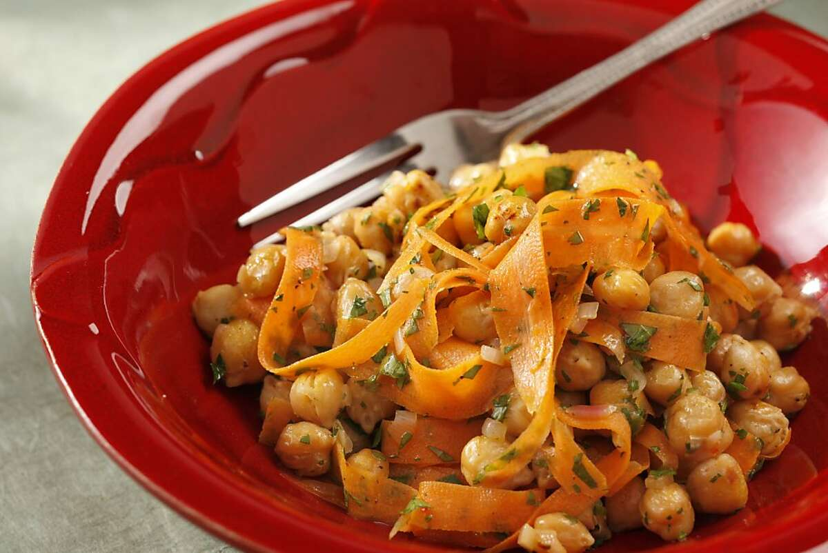 Chickpea salad with shaved carrots as seen in San Francisco, California, on Wednesday, April 13, 2011. Food styled by Sophie Brickman.