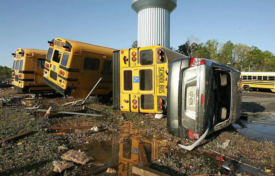 Several busses and cars were overturned at Page Middle School on Sunday, April 17, 2011 after a strong storm swept through Williamsburg, Virginia. (Rob Ostermaier/Newport News Daily Press/MCT) Photo: Rob Ostermaier, MCT