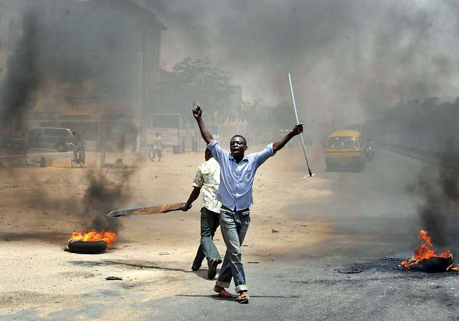 People holding wooden and metal sticks demonstrate in Nigeria's northern city of Kano where running battles broke out between protesters and soldiers on April 18, 2011 as President Goodluck Jonathan headed for an election win. Protesting youths challengedsoldiers deployed to the streets, who sought to push them back. Photo: Seyllou Diallo, AFP/Getty Images
