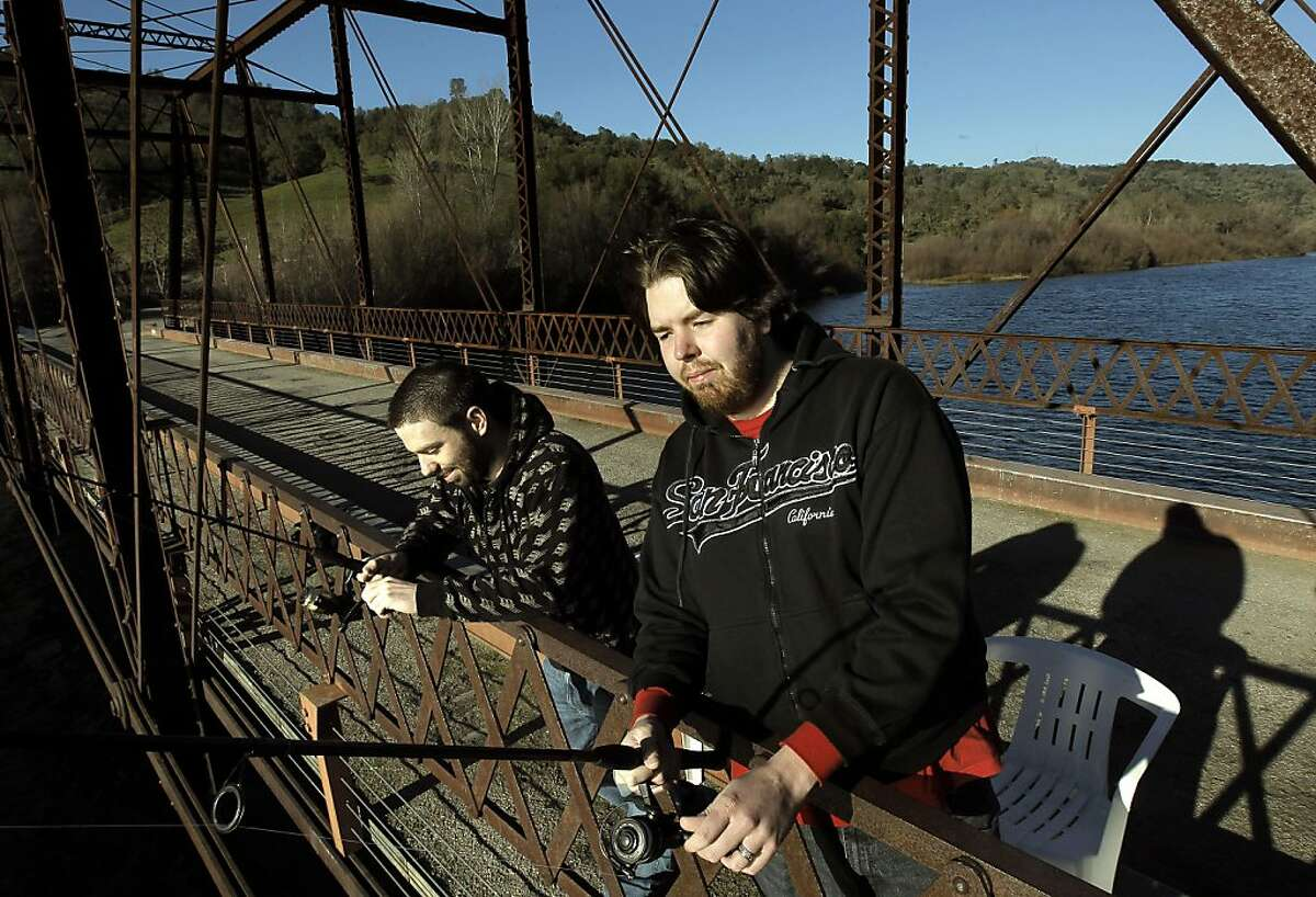 Mike Farrell, (left) and Robert Cheary, both from Mokelumne Hill, Ca., fish from the Middle Bar Bridge, on Thursday Jan. 27, 2011, in Jackson, Ca., which will be under water if the expansion of Pardee Reservoir is approved. A coalition of conservation and fishing groups has filed a lawsuit over the East Bay Municipal Utility District's plan to expand the Sierra Foothill's reservoir.