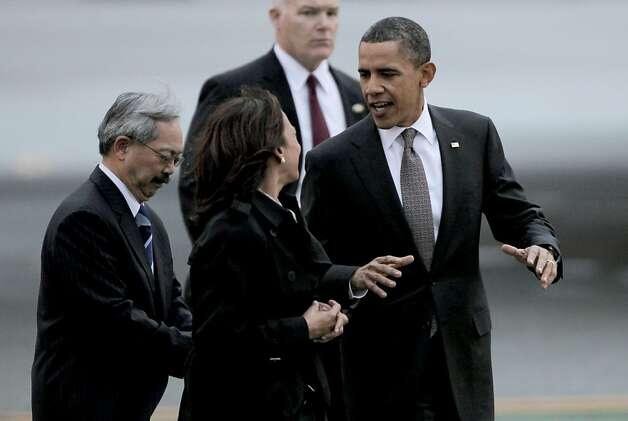 President Barack Obama walks with State Attorney General Kamala Harris and San Francisco Mayor Ed Lee upon his arrival aboard Air Force One, at San Francisco International airport, on Thursday Feb. 17, 2011,  for a one day visit with local business leaders in the fields of technology and innovation. Photo: Michael Macor, The Chronicle