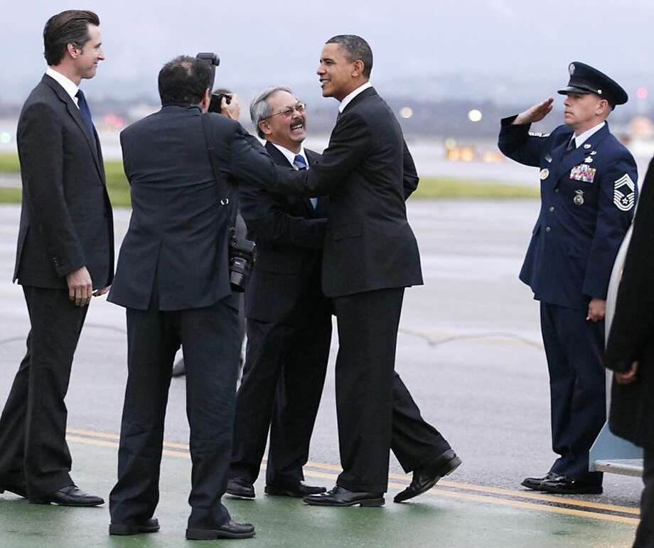 President Barack Obama, second from right, is greeted by California Lt. Gov. Gavin Newsom, left, and San Francisco Mayor Ed Lee, third from right, as he steps off of Air Force One, Thursday, Feb. 17, 2011, in San Francisco, as he arrives at San FranciscoInternational Airport. Photo: Carolyn Kaster, AP
