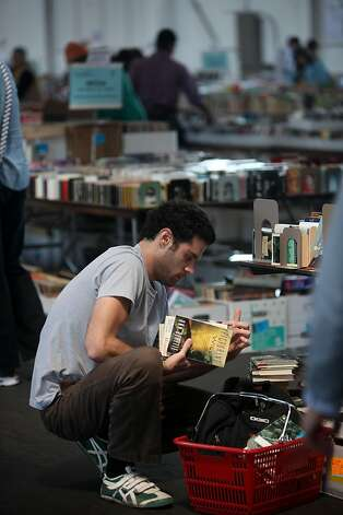 Peter Zuppardo of San Francisco sorts through books at the Friends of the San Francisco Public LibraryÍs special 50th Anniversary book sale at Fort Mason in San Francisco, Calif., Thursday, April 21, 2011. Photo: Lea Suzuki, The Chronicle