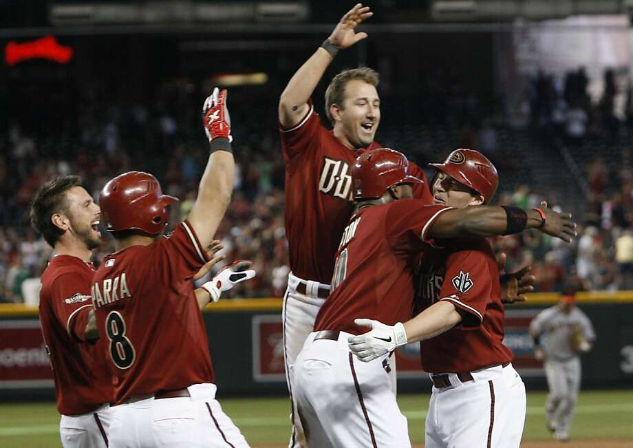 Arizona Diamondbacks' Stephen Drew, right, celebrates his game-winning hit against the San Francisco Giants with teammates Ryan Roberts, left, Gerardo Parra (8), Willie Bloomquist, top, and Justin Upton in a baseball game Sunday, April 17, 2011, in Phoenix.  The Diamondbacks defeated the Giants 6-5 in 12 innings. Photo: Ross D. Franklin, AP