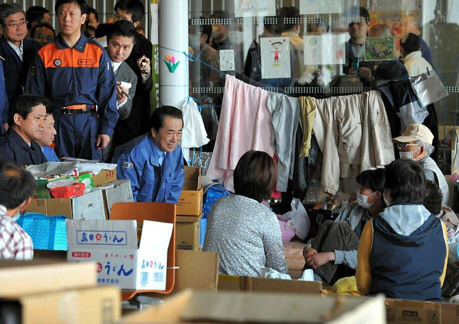 Japanese Prime Minister Naoto Kan (C) talks with evacuees at a shelter at Koriyama city in Fukushima prefecture on April 21, 2011. Japanese government declared the 20-kilometre evacuation area around the stricken Fukushima nuclear plant a legal no-entry zone. JAPAN OUT Photo: -, AFP/Getty Images