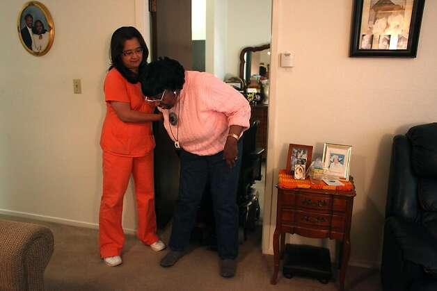 Anna Medina, caregiver, helps Patience Scales as she gets up from her wheelchair at her home in Pacifica, Calif., Friday, April 22, 2011. Photo: Lea Suzuki, The Chronicle