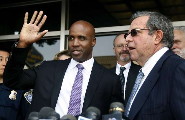 Barry Bonds waves to a supporter while his attorney Allen Ruby speaks after Bonds was convicted on one count of obstruction of justice at his perjury trial at the Phillip Burton Federal Courthouse in San Francisco, Calif. on Wednesday, April 13, 2011. The jury deadlocked on three other counts. Photo: Paul Chinn, The Chronicle