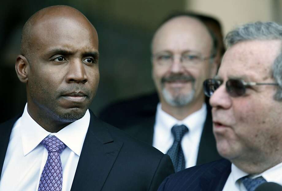 Former baseball home run king Barry Bonds looks on as Allen Ruby his lead attorney talks to reporters outside the federal courthouse after Bonds' was found guilty on one of four remaining counts in his perjury trial in San Francisco, Wednesday, April 13, 2011. Photo: Lance Iversen, The Chronicle