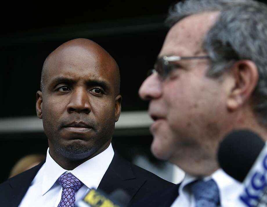 Barry Bonds listens to his attorney Allen Ruby address the news media after Bonds was convicted on one count of obstruction of justice at his perjury trial at the Phillip Burton Federal Courthouse in San Francisco, Calif. on Wednesday, April 13, 2011. The jury deadlocked on three other counts. Photo: Paul Chinn, The Chronicle