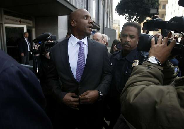 Barry Bonds makes his through a crowd of reporters and photographers after he was convicted on one count of obstruction of justice at his perjury trial at the Phillip Burton Federal Courthouse in San Francisco, Calif. on Wednesday, April 13, 2011. The jury deadlocked on three other counts. Photo: Paul Chinn, The Chronicle