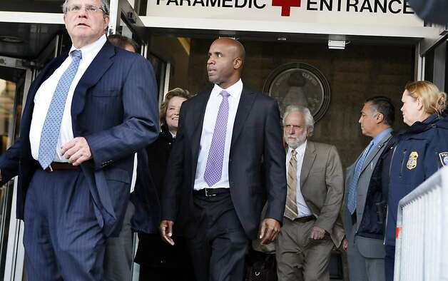 Allen Ruby left, Barry Bonds, lead attorney leads Bonds and his team  outside the federal courthouse after Bonds' was found guilty on one of four remaining counts in his perjury trial in San Francisco, Wednesday, April 13, 2011. Photo: Lance Iversen, The Chronicle