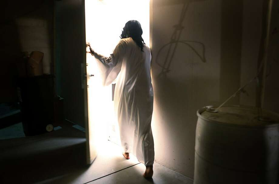 Dressed in Jesus attire, Michael Davidson, 45, heads back to his dressing room after the resurrection scene during the dress rehearsal of the Easter Outreach program at Abundant Life Christian Fellowship on Tuesday April 12, 2011 in Mt. View, Calif. Photo: Mike Kepka, The Chronicle