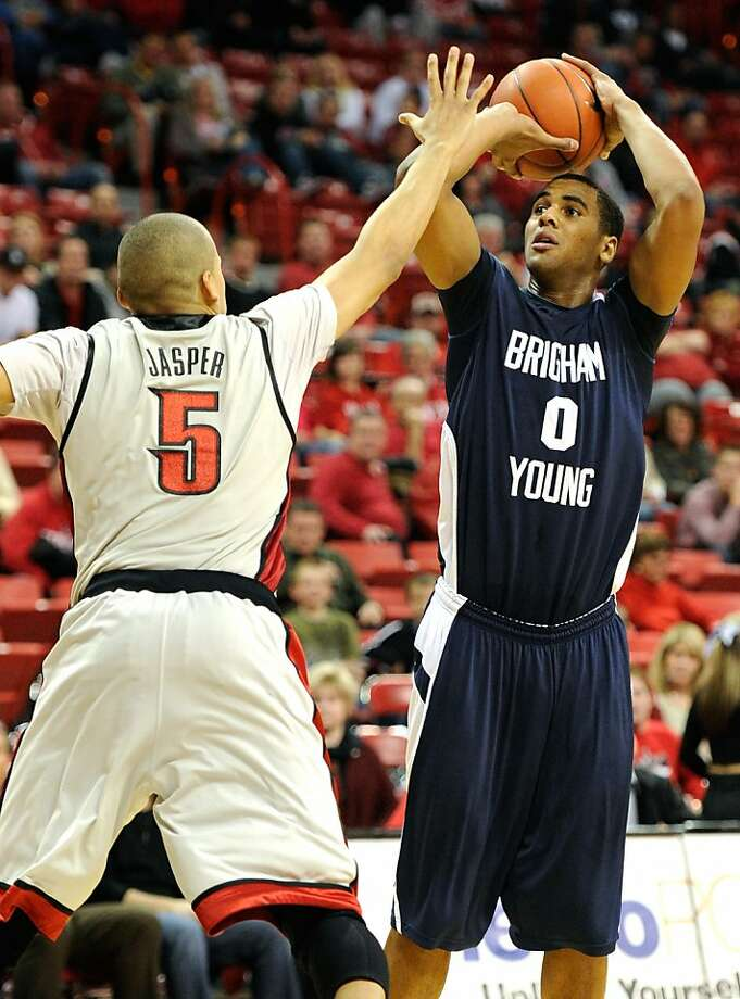 LAS VEGAS, NV - FILE: Brandon Davies #0 of the Brigham Young University Cougars shoots against Derrick Jasper #5 of the UNLV Rebels during their game at the Thomas & Mack Center January 5, 2011 in Las Vegas, Nevada. According to reports on March 3, 2011,Davies was suspended from the basketball team for having premarital sex. Photo: Ethan Miller, Getty Images