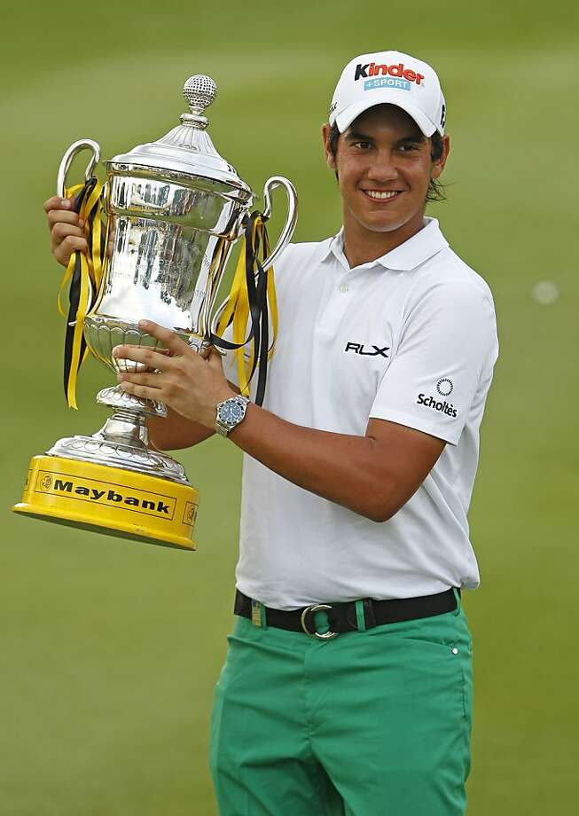 Matteo Manassero from Italy poses with his trophy after winning the Malaysian Open golf tournament in Kuala Lumpur, Malaysia, Sunday, April 17, 2011. Photo: Vincent Thian, AP