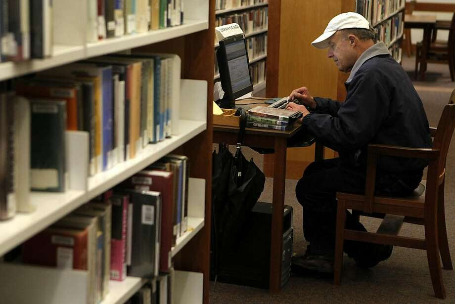 """Louis Capellino of Piedmont searches for books at Rockridge Branch Library in Oakland, Calif., on Friday, March 18, 2011. Capellino said that after Piedmont spent funds for a study on building the Blair Park sports complex that, """"...it's a shame they're cutting library services."""" Photo: Thomas Levinson, The Chronicle"""