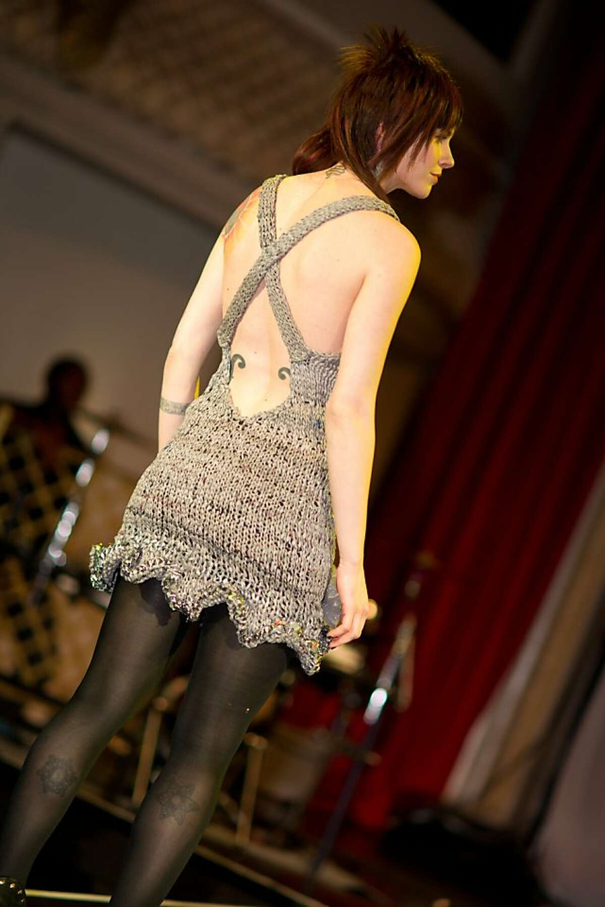 Kelly Koehler modeled dress made of plastic bags designed by Shaun Muscolo at