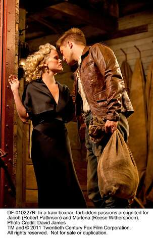 WATER FOR ELEPHANTS In a train boxcar, forbidden passions are ignited for Jacob (Robert Pattinson) and Marlena (Reese Witherspoon). Photo: David James, Twentieth Century Fox