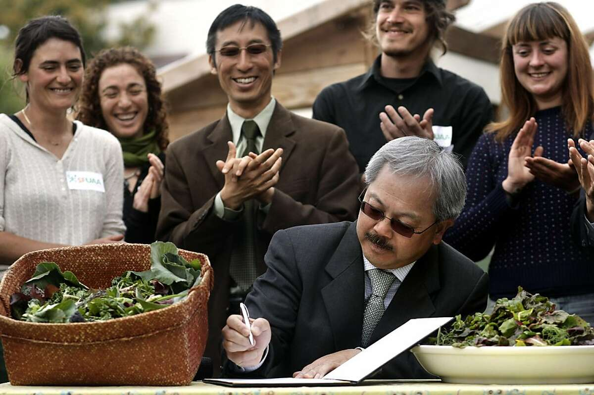 Garden supporters gathered at Little City Gardens on Wednesday April 20, 2011, applaud as San Francisco Mayor Ed Lee signs into law the new agricultural zoning ordinance that amends the Planning code to encourage edible gardening and urban farming within the city and county of San Francisco. Signing ceremony in San Francisco, Ca.