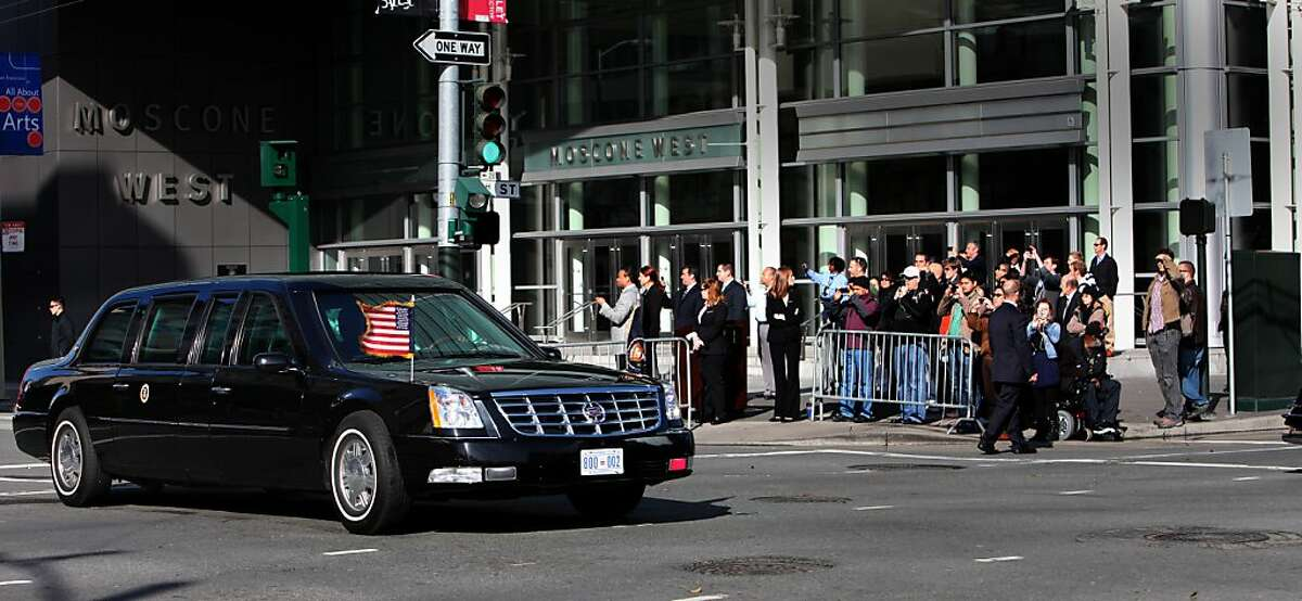 People watch as President Obama's motorcade passes by on Howard Street at in San Francisco, Calif., Thursday, April 21, 2011.