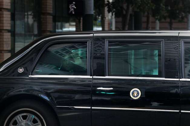 President Obama waves to people as his motorcade drives on on Mission Street at in San Francisco, Calif., Thursday, April 21, 2011. Photo: Lea Suzuki, The Chronicle