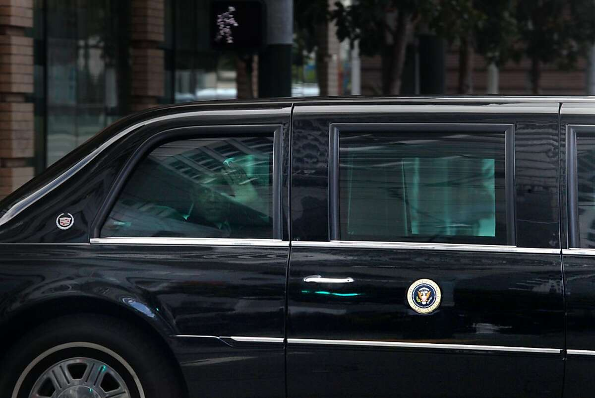 President Obama waves to people as his motorcade drives on on Mission Street at in San Francisco, Calif., Thursday, April 21, 2011.