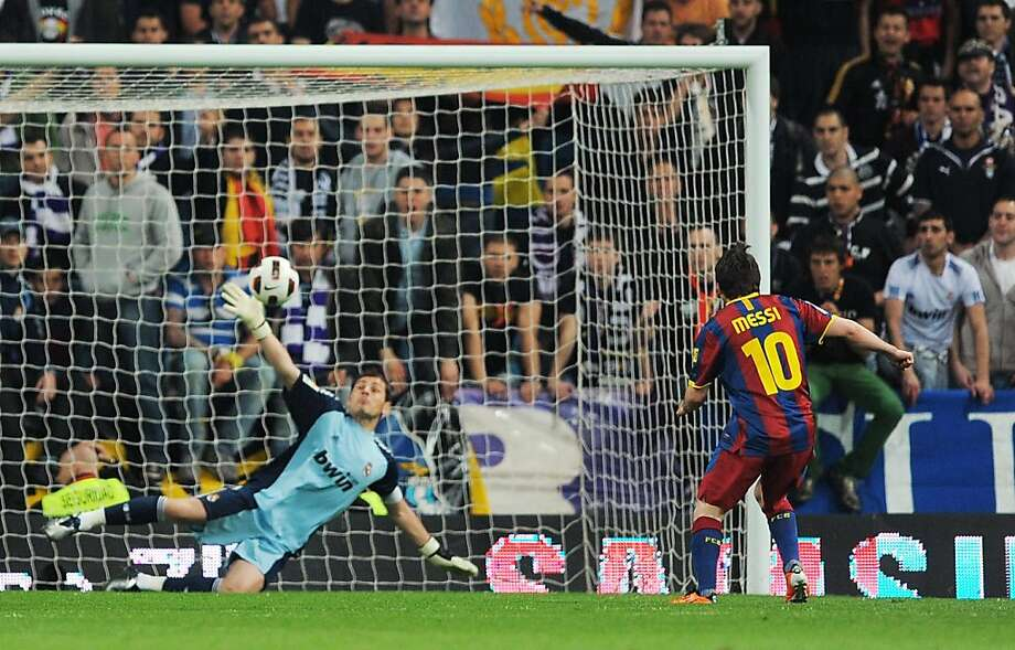 MADRID, SPAIN - APRIL 16:  Lionel Messi of Barcelona beats Real Madrid's goalkeeper Iker Casillas from the penalty spot to score Barcelona's opening goal  tduring the La Liga match between Real Madrid and Barcelona at Estadio Santiago Bernabeu on April 16, 2011 in Madrid, Spain. Photo: Denis Doyle, Getty Images