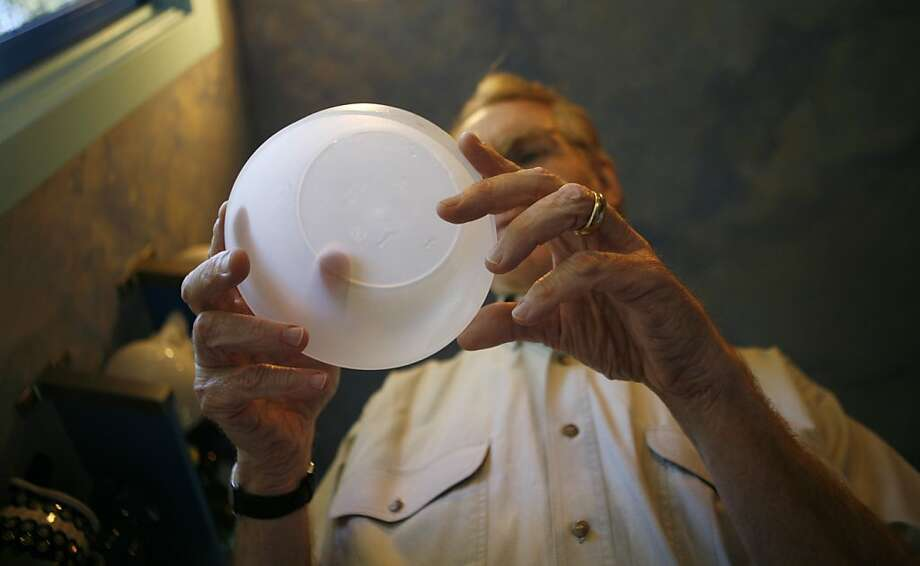 Orinda resident Greg Kelly looks for a number seven, which represents containers with BPA, on the bottom of a plastic bowl. Kelly is giving plastics in his kitchen a serious look after reading reports that BPA leaches into food. Photo: Anna Vignet, The Chronicle