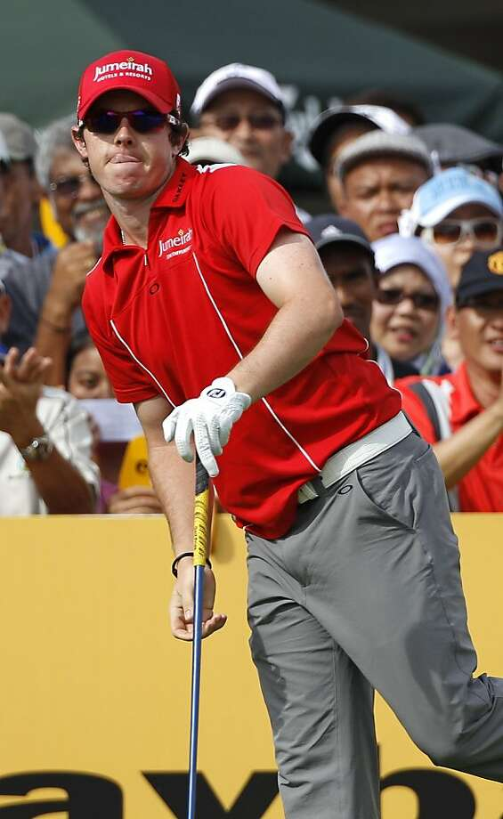 Rory McIlroy of Northern Ireland watches his shot at first hole during the third round of Malaysian Open golf tournament in Kuala Lumpur, Malaysia, Saturday, April 16, 2011. Photo: Vincent Thian, AP