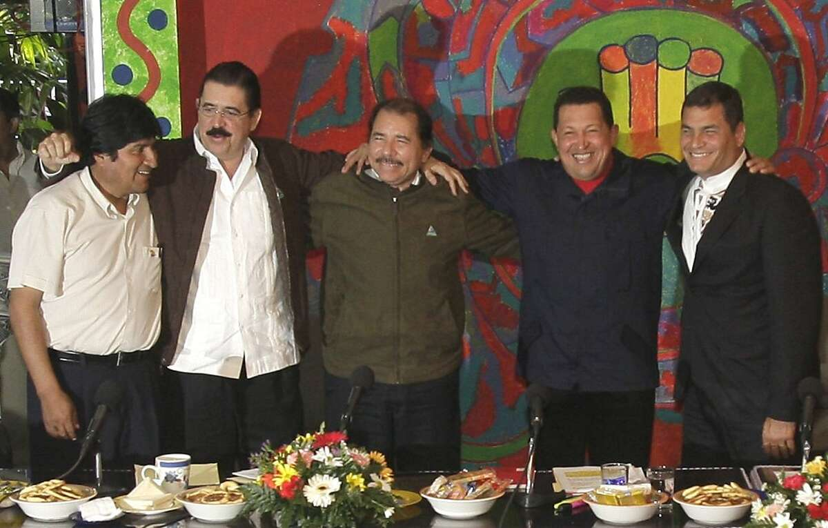 FILE - In this June 29, 2009 file photo, Bolivia's President Evo Morales, left, Honduras' ousted President Manuel Zelaya, second left, Nicaragua's President Daniel Ortega, third left, Venezuela's President Hugo Chavez, fourth left, and Ecuador's President Rafael Correa pose for a photo at the Bolivarian Alternative of the Americas group, or ALBA, in Managua. A new wave of popular presidents is trying to do away with term limits, arguing they impede real change. As leaders move to extend their rule, opponents fearing a return to the caudillo era have done everything from throw eggs to stage coups to stop them. (AP Photo/Arnulfo Franco, File)