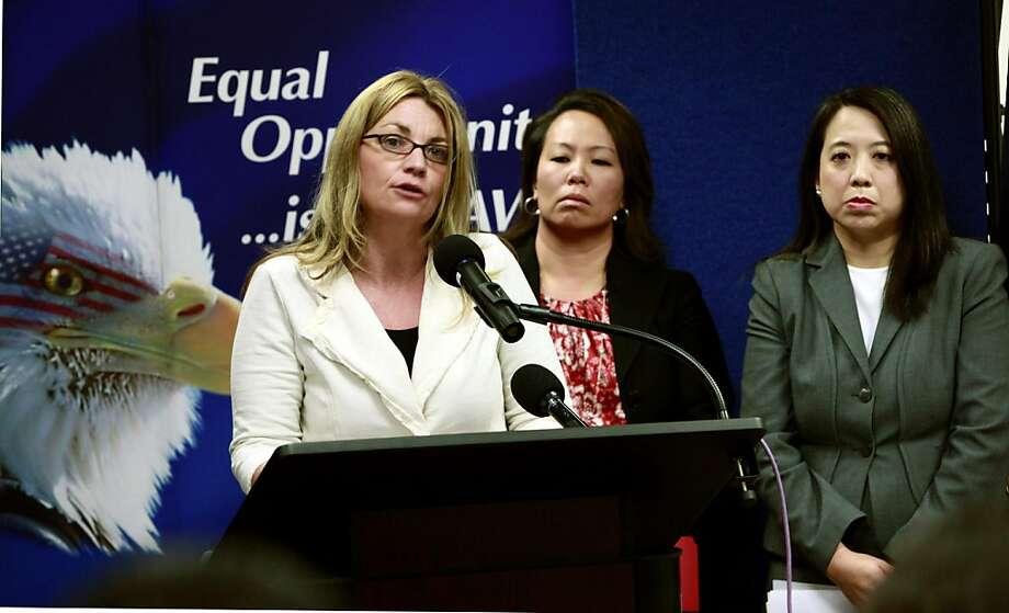 Kay Buck, left, executive director of the Coalition to Abolish Slavery Trafficking, speaks at a news conference Wednesday, April 20, 2011, to announce the filing of a human trafficking lawsuit that stretches  across California , Hawaii, and Washington.  Anna Park, regional attorney for the EEOC in the Los Angeles District, center, and Chanchanit Martorell, executive director for the Thai Community Development Center, listens in. Photo: Nick Ut, AP