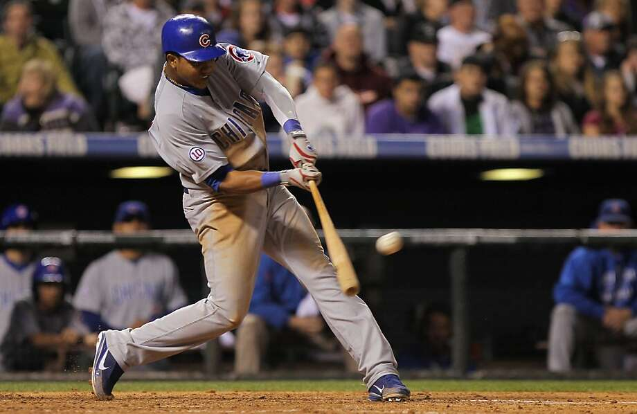 DENVER, CO - APRIL 16:  Starlin Castro #13 of the Chicago Cubs hits a three run homerun off of relief pitcher Felipe Paulino #55 of the Colorado Rockies in the seventh inning at Coors Field on April 16, 2011 in Denver, Colorado. Photo: Doug Pensinger, Getty Images