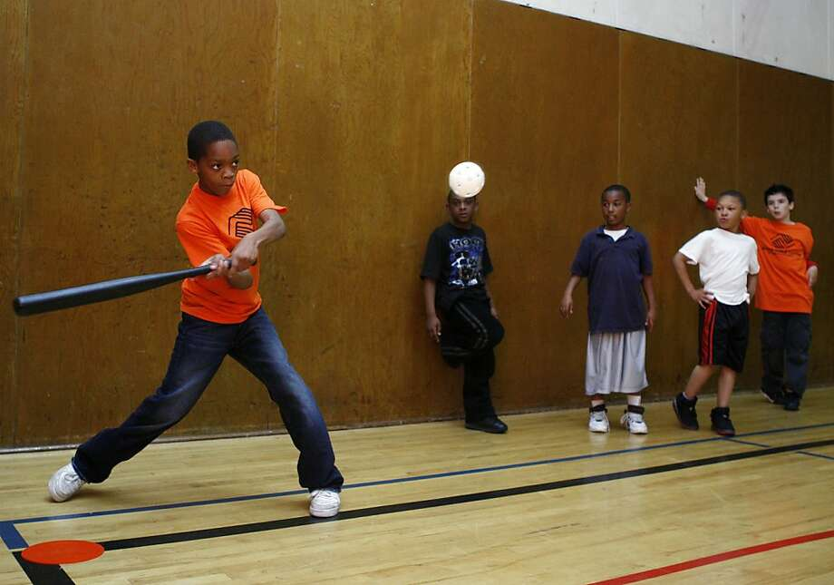 Boys and girls club member Gary Ray plays baseball indoors at the Ernest Ingold Clubhouse in San Francisco Calif, on Tuesday, April 19, 2011. Several youths from the club will have the chance to attend a fundraiser for President Barack Obama tomorrow in San Francisco and perhaps be able to speak with him. Photo: Alex Washburn, The Chronicle