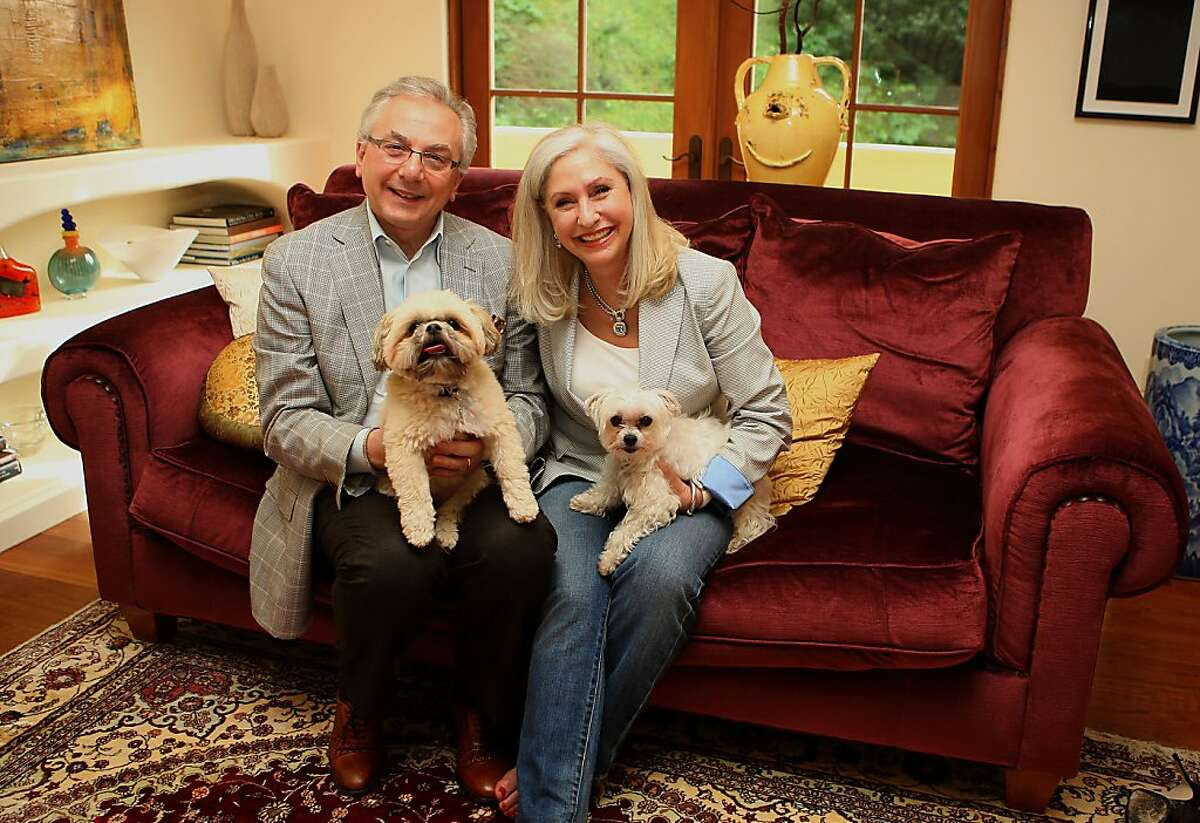 Perbacco owner Umberto Gibin and his wife, Leslie Levine at home with Lucy (left) and Manny (right) in Oakland, Calif., on Friday, April 1.