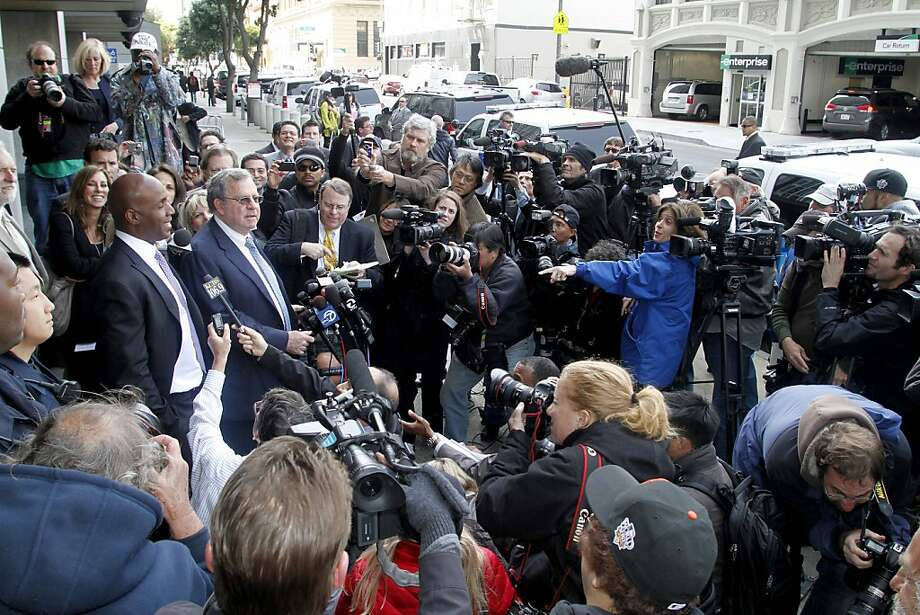 Barry Bonds, left, and his attorney Allen Ruby face the media outside a federal court building Wednesday, April 13, 2011, in San Francisco. The former baseball player was convicted of one count of obstruction of justice. The jury failed to reach a verdicton the three counts at the heart of allegations that he knowingly used steroids and human growth hormone and lied to a grand jury about it. Photo: George Nikitin, AP