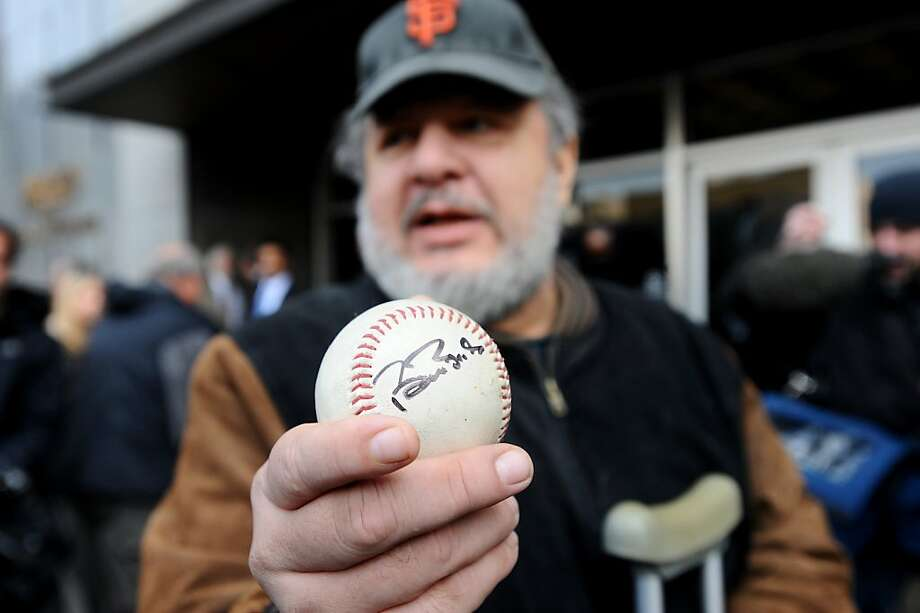 San Francisco Giants fan Thomas Peterson holds a baseball that Barry Bonds signed as he left federal court Wednesday, April 13, 2011, in San Francisco. A federal jury convicted Bonds of a single charge of obstruction of justice Wednesday but failed to reach a verdict on the three counts at the heart of allegations that he knowingly used steroids and human growth hormone and lied to a grand jury about it. Photo: Noah Berger, AP
