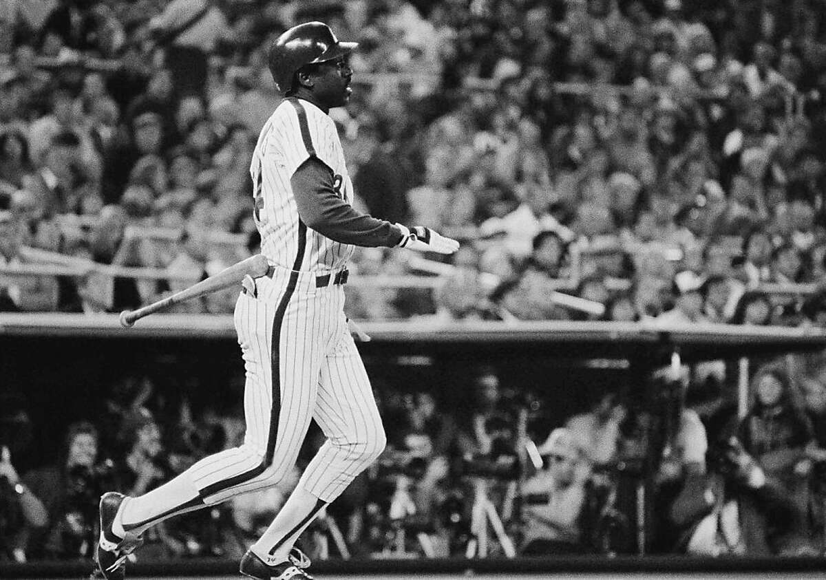 Philadelphia Phillies batter Gary Matthews flips his bat and watches his solo homer off Baltimore Orioles pitcher Mike Flanagan head out in the second inning of the World Series, Friday, Oct. 14, 1983, Philadelphia, Pa. (AP Photo)