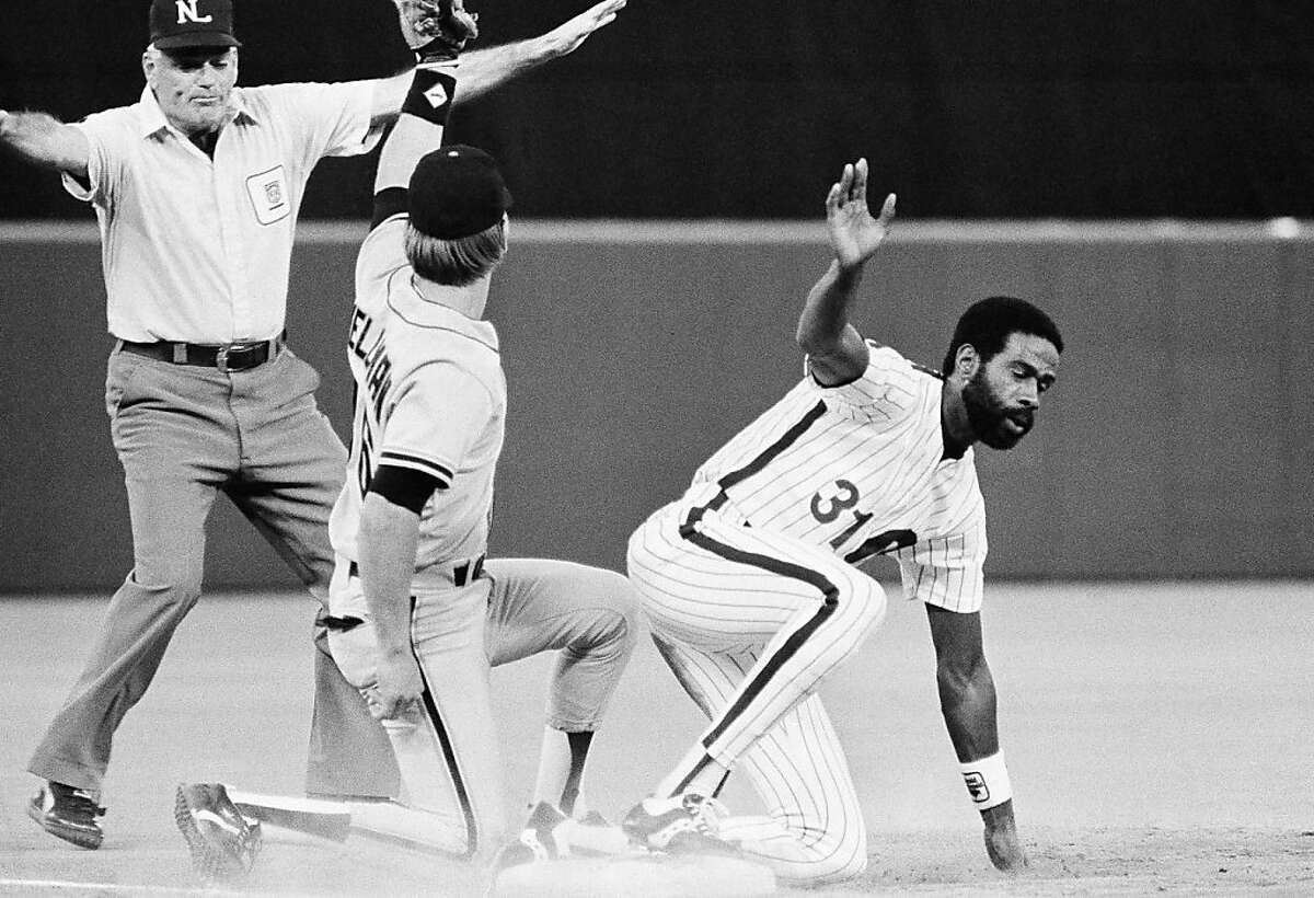 Philadelphia Phillies Garry Maddox arrives safely at third base ahead of the tag by San Francisco Giants Brad Wellman in the fourth ining of play in Philadelphia on Wednesday, May 22, 1985. Maddox stole second and advanced to third on a throwing error by Giants catcher Bob Brenly. umpire is John Kibler. (AP Photo/Peter Morgan).