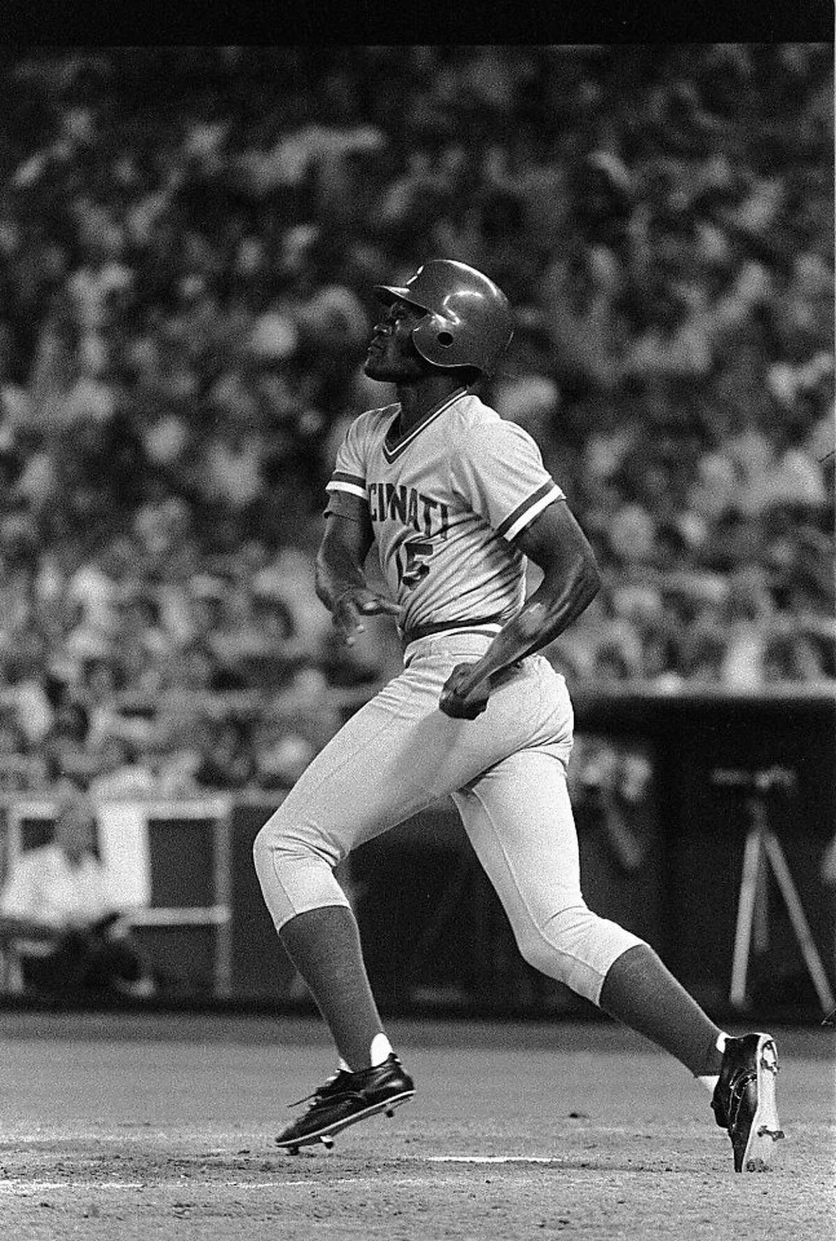 Cincinnati Reds George Foster pauses at the plate as he watches the ball on his grand slam home run in the 8th inning of July 20, 1978 night game in Philadelphia. It was Foster's 23rd home run of the season. The Reds won, 7-2. (AP Photo/rbk)
