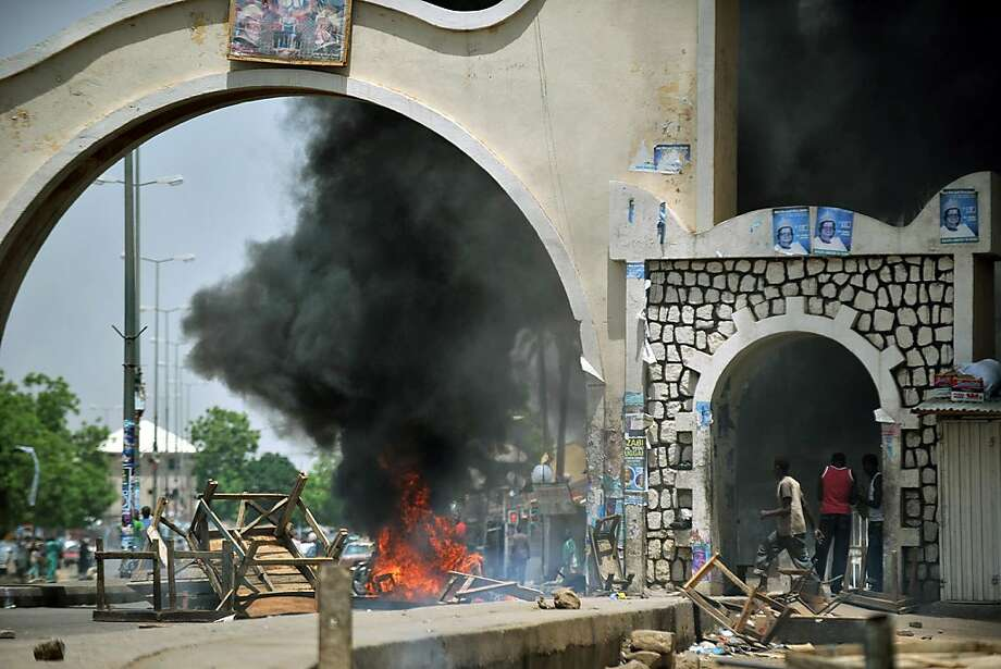 A picture taken on April 18, 2011 shows Nigerian youth lighting fires on a street of Bauchi, capital of Bauchi state, nothern Nigeria. Nigeria's Goodluck Jonathan has been declared winner of presidential elections in a landmark vote that exposed regionaltensions and led to deadly rioting in the mainly Muslim north. The vote showed a country deeply divided between its predominately Christian south and economically marginalised north, where deadly riots broke out and eventually spread to some 14 states after results began to be released. Photo: Tony Karumba, AFP/Getty Images