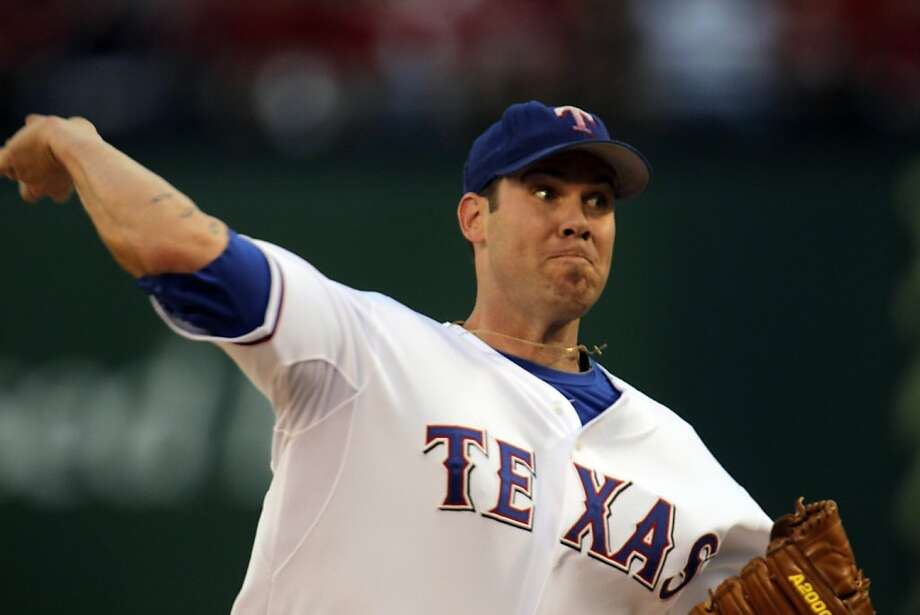 Texas Rangers starting pitcher Colby Lewis (48) throws a pitch in the first inning during game 3 of the 2010 World Series between the San Francisco Giants and the Texas Rangers on Saturday, Oct. 30, 2010 in Arlington, Tx. Photo: Michael Macor, San Francisco Chronicle