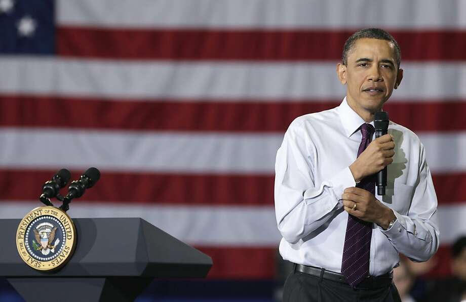President Barack Obama rolls up his sleeves during town hall meeting at North Virginia Community College in Annandale, Va., Tuesday, April 19, 2011. Photo: Carolyn Kaster, AP