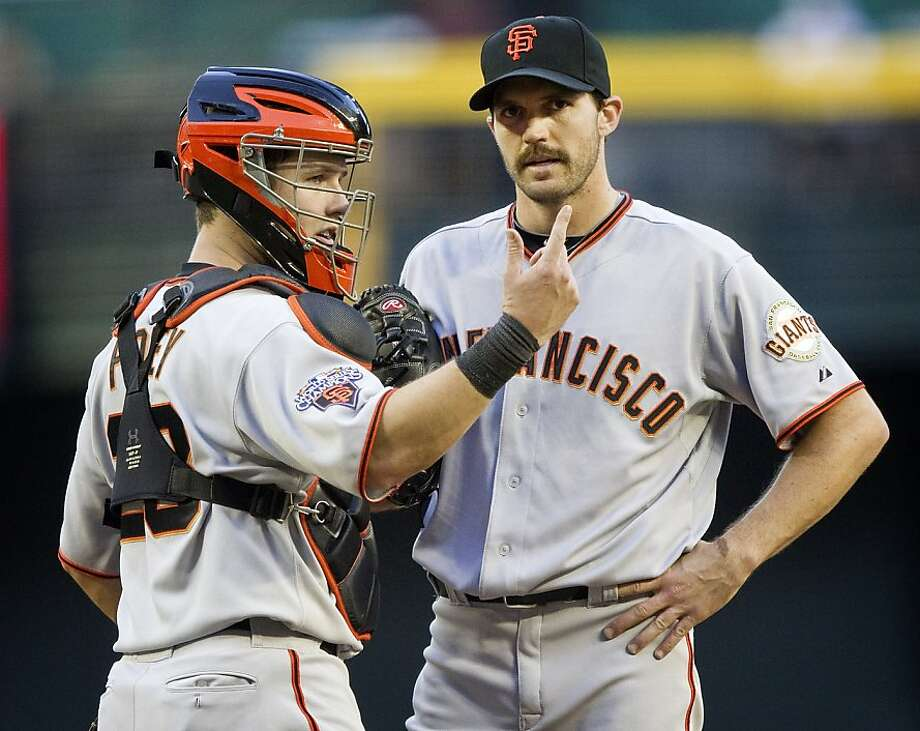 ** CORRECTS TO SECOND INNING NOT THIRD INNING ** San Francisco Giants catcher Buster Bosey, left, signals to a trainer as pitcher Barry ZIto looks away during the second inning of a baseball game against The Arizona Diamondbacks, Saturday, April 16, 2011,in Phoenix. Zito left the game. Photo: Matt York, Associated Press