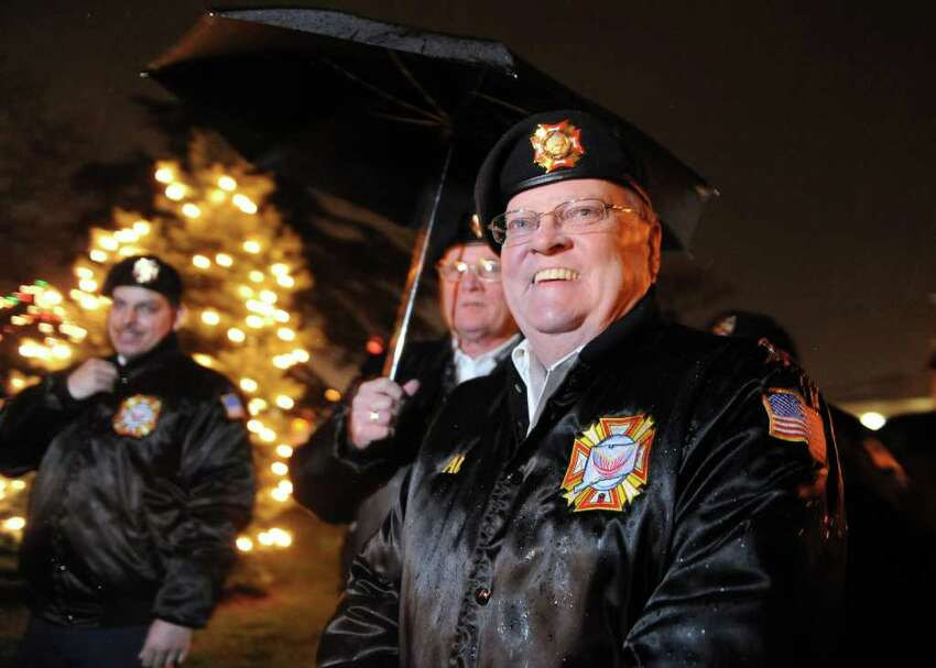Air Force veteran Al Foiw walks past the lights outside St. Patrick's Church in Bridgeport, Conn. during the annual tree lighting ceremony to commemorate the 70th anniversary of the attacks on Pearl Harbor Wednesday, Dec. 7, 2011.