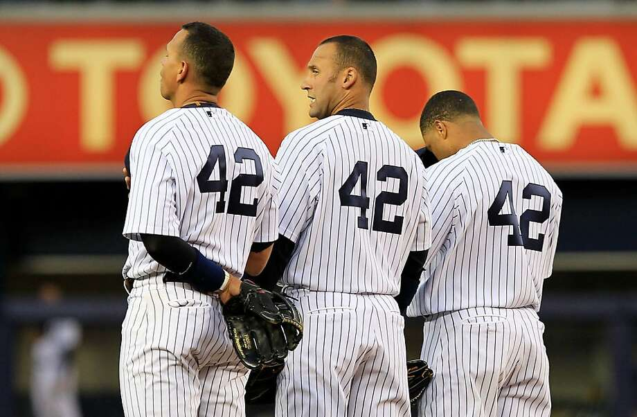 NEW YORK, NY - APRIL 15: (L-R) Alex Rodriguez, Derek Jeter and Robinson Cano of the New York Yankees wear #42 to commemorate Jackie Robinson day during the game against the Texas Rangers at Yankee Stadium on April 15, 2011 in the Bronx borough of New YorkCity. Photo: Chris Trotman, Getty Images