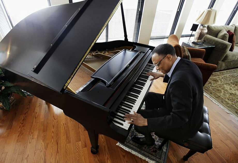 "In this photo taken April 5, 2011, jazz pianist and composer Ramsey Lewis plays the piano at his home in Chicago. His latest work is a tribute to Abraham Lincoln, ""Proclamation of Hope: A Symphonic Poem by Ramsey Lewis."" It airs nationally on PBS stations starting Thursday. Photo: M. Spencer Green, AP"